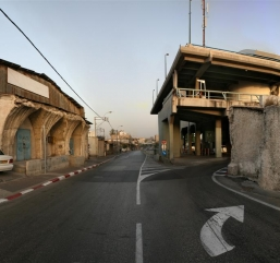 Broken_well-house_and_the_Tel_Aviv_Central_Bus_Station